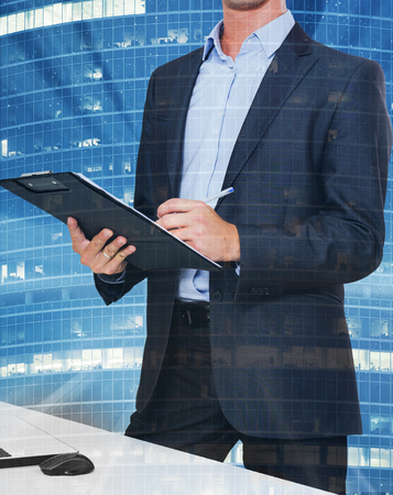 Businessman signing document on divergent rays on city landscape background Stock Photo