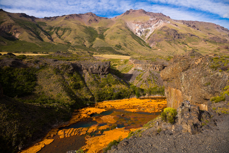View of Agrio river in stony valley near Salto del Agrio waterfall. Patagonia, Argentina Stock Photo