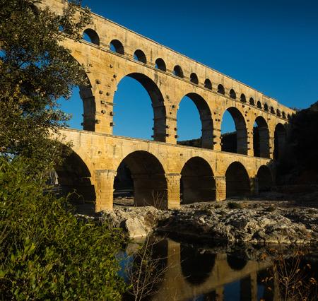 The Aqueduct Bridge is cultural landmark of France outdoors.