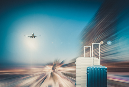 Suitcases of traveler awaiting landing aircraft on blur motion background