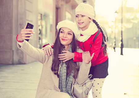 Couple  female and girl in the historical center taking selfie Stock Photo