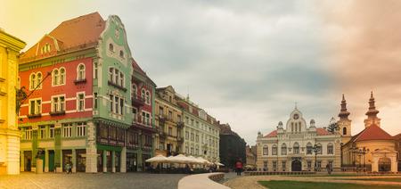 Colorful buildings in style baroque on Union Square (Piata Unirii) in Timisoara , Romania