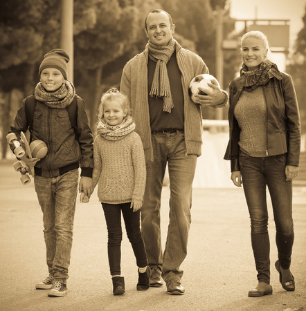 Autumn outdoor portrait of happy family with son and daughter Stock Photo