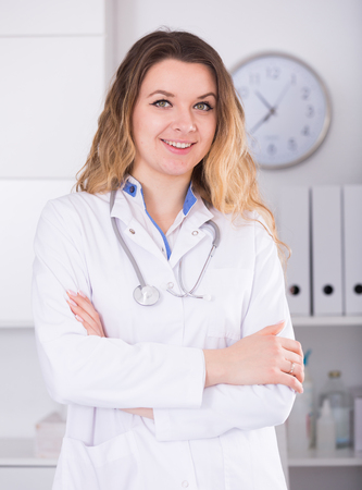 Portrait of young medical worker in medical Center standing near the table