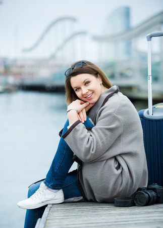 Portrait of adult girl with baggage relaxing at berth in winter day Stock Photo