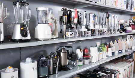 Image of different household appliances , kitchen blenders and juicers at shop