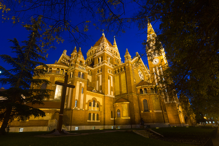 Night view of Votive Church and Cathedral on main square of Szeged, Hungary