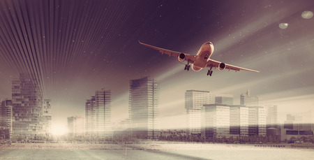 Aircraft circling in the sky above commercial buildings  写真素材