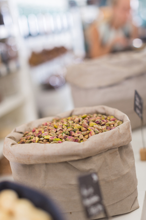 Photo of mix pistachios in the food store.