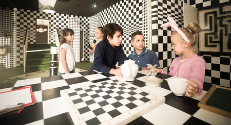 Enthusiastic european  children play in the chess quest room Stock Photo