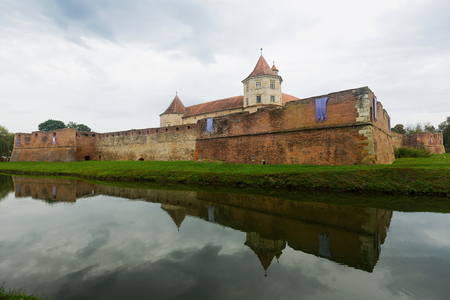 Castle on the lake is landmark of Fagaras in Romania.