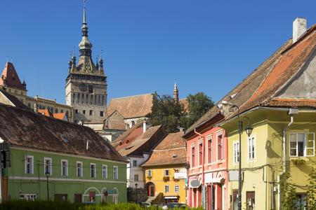 View on Clock tower in Sighisoara in Romania. 免版税图像