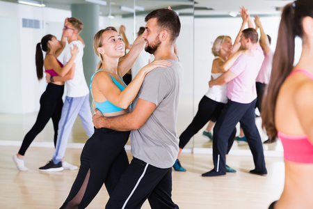Joyful dancing pair dance  together  in studio