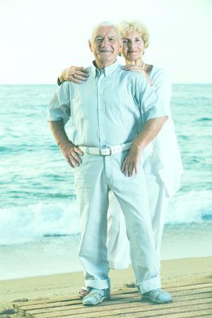 portrait of happy pensioners standing together on the sea coast Archivio Fotografico