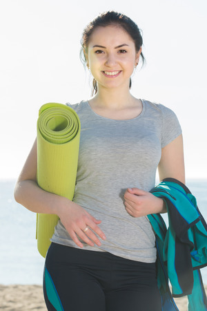 Young russian woman ready to start morning training on beach