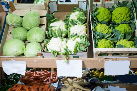 range of cauliflower and vegetables on the counter of the vegetable store