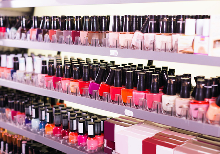 Variety of stylish, fashionable assortment of modern cosmetics store Banco de Imagens