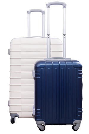 Two suitcases of different size with wheels standing upright