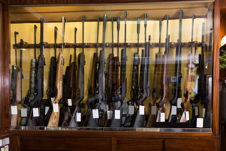 Gun store interior with rifles on showcase