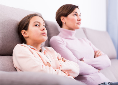 Mother and teenage daughter take offense at each other because of quarrel Stock Photo
