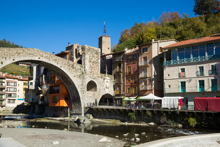View on town of Camprodon in Pyrenees at warm sunny day  Stock Photo