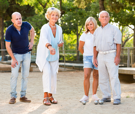 Cheerful  family playing petanque in outdoor