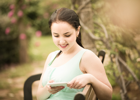 cheerful smiling young woman portrait in outdoors