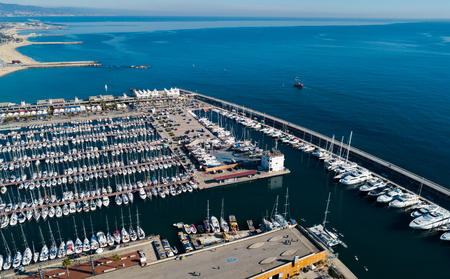 View from drone to Mediterranean seascape with yachts in marina of Barcelona