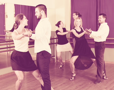 adult european men and women enjoying of tango in class Stock Photo - 102596246