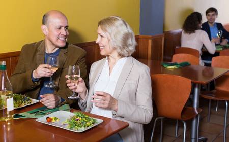 Mature  latina man and woman spending time together in restaurant