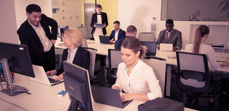Group of successful business people during daily work in modern co-working space