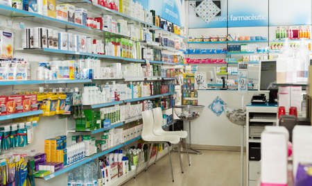 BARCELONA, SPAIN - MARCH 02, 2018: Interior of modern pharmacy with medicines, cosmetics and products for healthcare on shelves