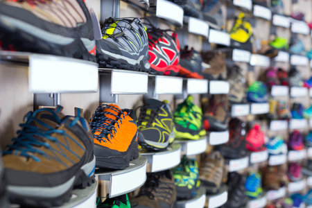 Image of sneakers on shelves of sport store.