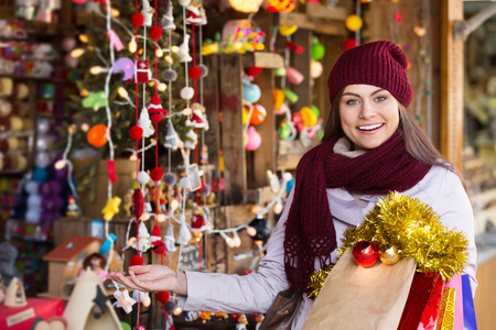 Portrait of female customer near counter with a Christmas gifts