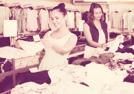 Smiling young women shopping panties at the apparel store