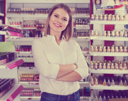 Young stylish woman customer posing in cosmetics store Stock Photo