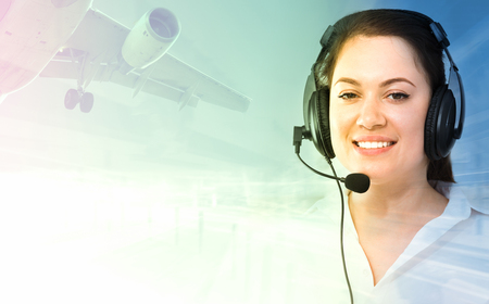 Woman dispatcher assisting in navigating airplanes during day