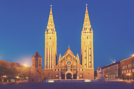 Illustration of view on Cathedral in night light of Szeged in Hungary.