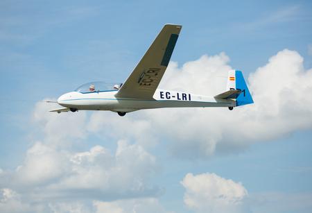 IGUALADA, SPAIN - MAY 20, 2018: Light airplane demonstrating flying capabilities in sky of Igualada-Odena aerodrome on 26th airshow Aerosport