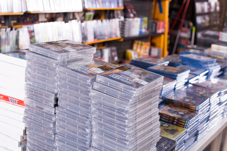 BARCELONA, SPAIN - FEBRUARY 15, 2018: Large collection of movies on DVD for sale on piles at shop Editorial