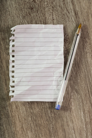 crumpled sheet notebook line with ballpoint pen