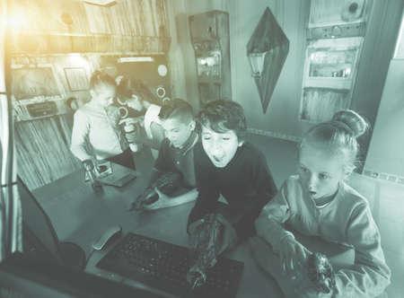 five children playing in bunker quest room