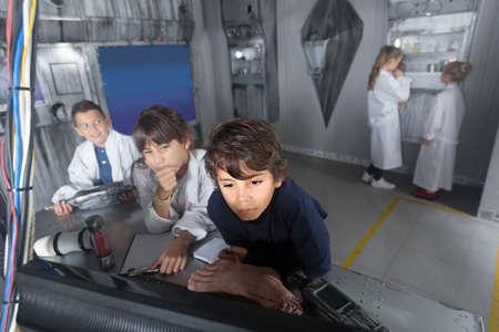 positive czech сhildren playing in bunker quest room