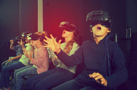 Rapturous children are looking for way out of virtual quest room Stock fotó - 104567376
