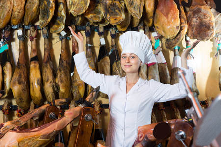 Portrait of woman selling delicious prosciutto meat on market