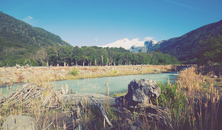 View from valley of river Cauquenes to mountain Tronador and glacier on summer day. Patagonia, Argentina Stock Photo