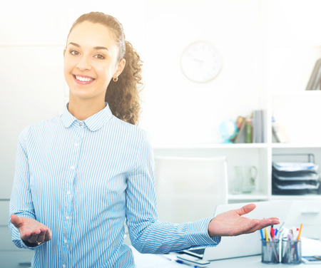 Successful and confident young woman working in modern office Stock Photo