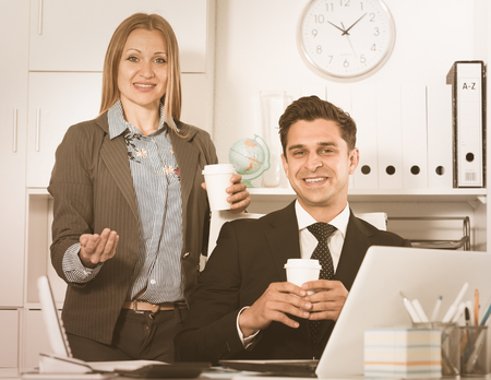 Focused business team working with computer in modern office
