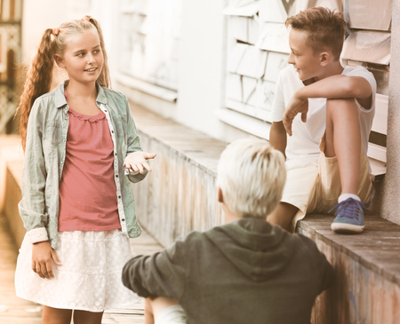 Happy kids funny spending time together outdoors having conversation
