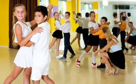 Happy children studying of partner dance  at dance classes Stock Photo